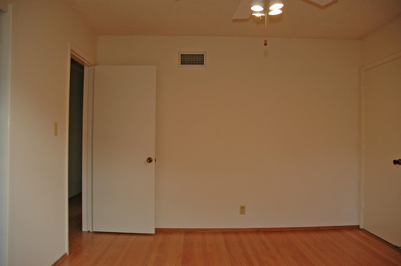 Another view of the bedroom with garage access.