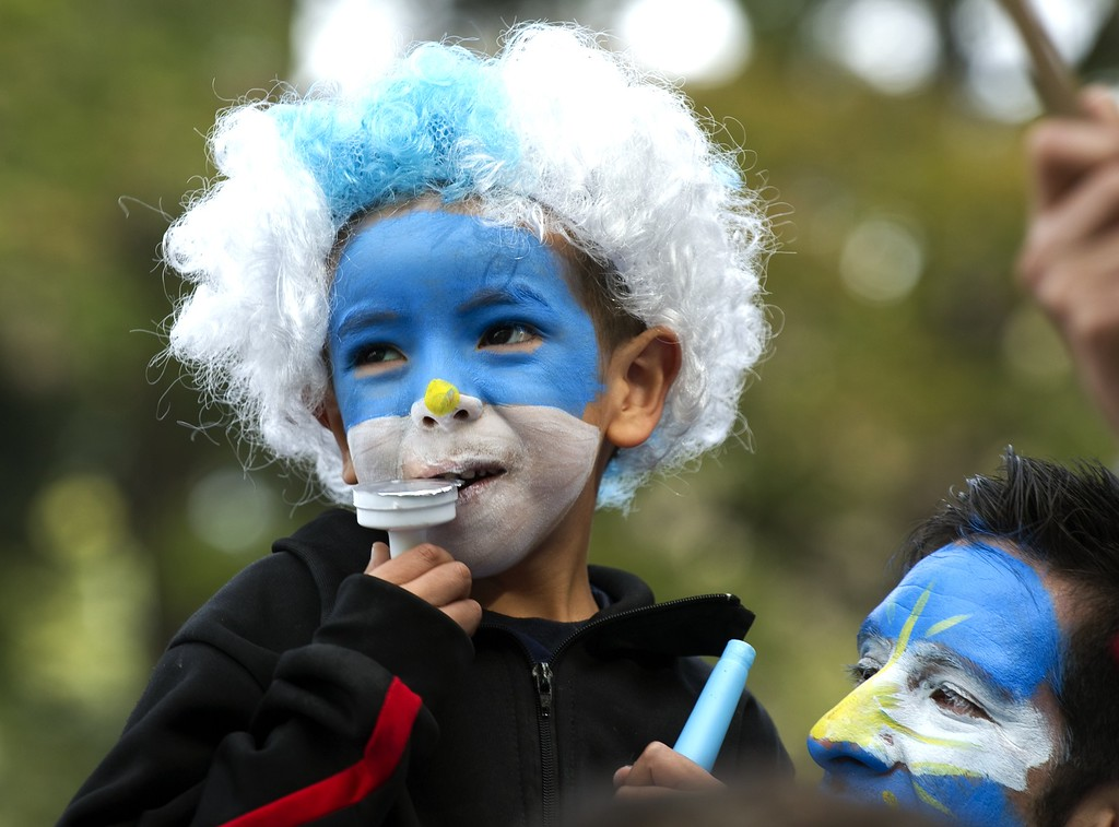 . Argentine fans watch the FIFA World Cup Brazil 2014 match between Argentina and Nigeria on a large screen at San Martin square in Buenos Aires on June 25, 2014. AFP PHOTO / Alejandro  PAGNI/AFP/Getty Images