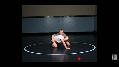 Cross wrist to near side cradle while on knees