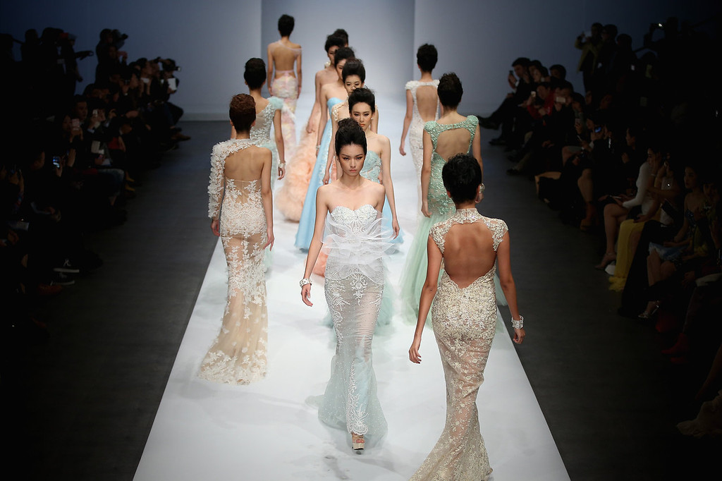 . Models showcase designs by Chinese designer Zhang Jingjing on the runway at Zhang Jingjing Haute Couture Collection show during Mercedes-Benz China Fashion Week Spring/Summer 2014 at 751 D-PARK Central Halll on October 26, 2013 in Beijing, China.  (Photo by Feng Li/Getty Images)