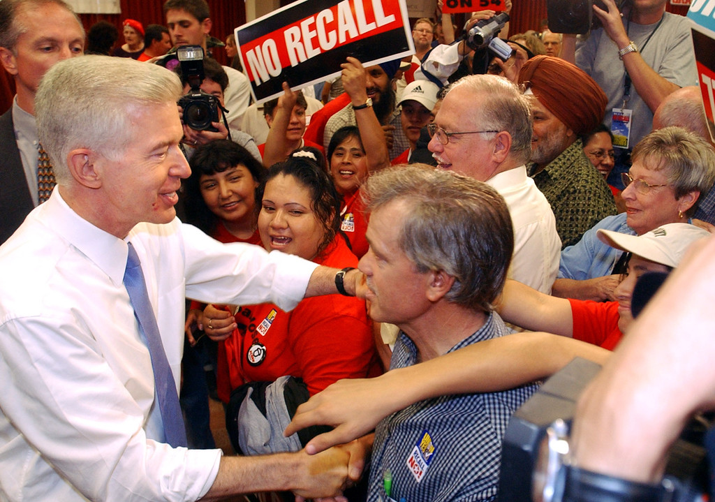 . California Gov. Gray Davis shakes hands with supporters at a labor rally at IBEW Hall in San Jose on Sunday, Oct. 5, 2003, part of his three-day anti-recall \'Just Say No!\'  fly-around.  The recall election will take place Oct. 7. (AP Photo/Jakub Mosur)