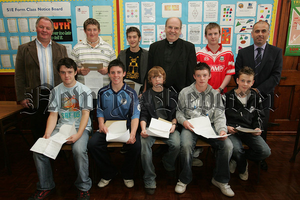 Pictured with the students from St Colman's College who recieved their G.C.S.E. results on Tuesday last are, Principal Dr. Francis Brown, Mr Barry Kelly VP and Mr Michael Doyle VP. 07W35N1