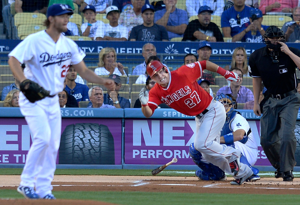 . In the first inning, Angels Mike Trout runs to first base safely as he hit a single in the first inning. Dodger pitching ace Clayton Kershaw. Los Angeles CA. 8/5/2014(Photo by John McCoy Daily News)