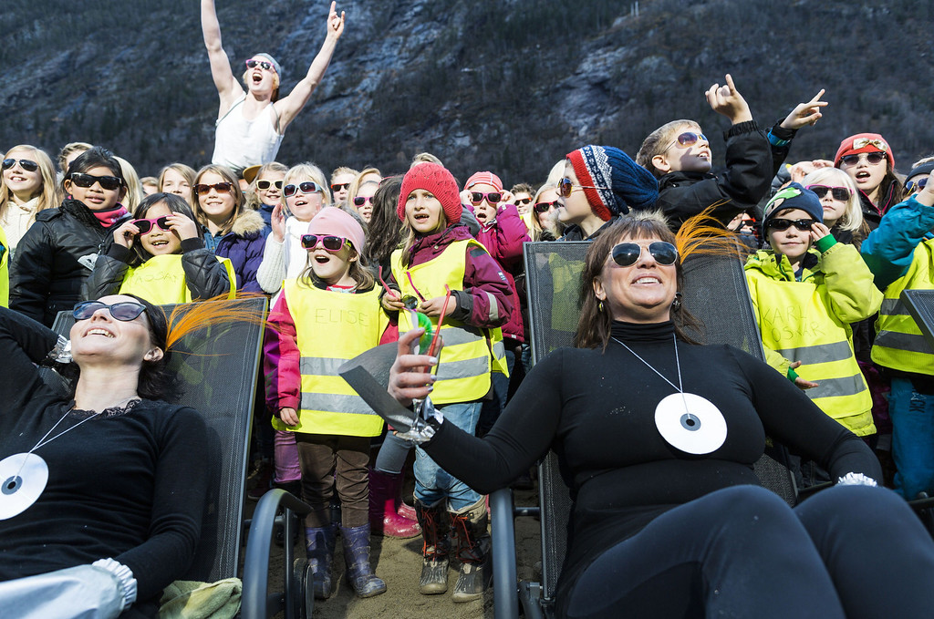 """. People cheer during an inauguration of the huge sun mirrors (\""""Solspeilet\"""") set up on the hillside above Rjukan, to reflect sunlight down on the town square, on October 30, 2013,100 years after the idea was first released.  AFP PHOTO / KRISTER SOERBOE/AFP/Getty Images"""