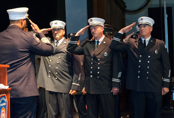 09/20/18 Wesley Bunnell | Staff The New Britain Fire Department held their 2018 Awards Ceremony on Thursday September 20 at Trinity on Main. Fire Chief Raul Ortiz, L, salutes recipients of the Rescue Award which included Lt. Michael Sanzaro, Captain James Brophy, middle, and Captain Michael Berry, R, along with 11 other members.