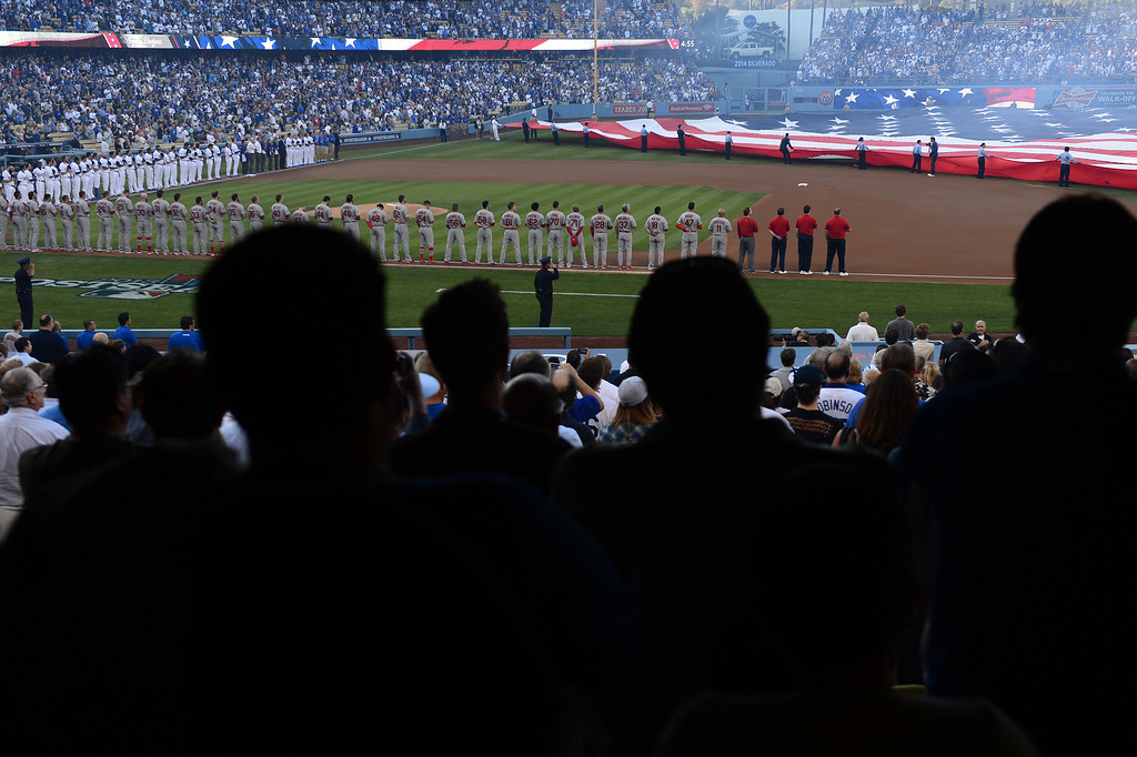 . Dodger  fans stand for the National Anthem during game 3 of the NLCS at Dodger Stadium Monday, October 14, 2013. The Dodgers beat the Cardinals 3-0. (Photo by Sarah Reingewirtz/Los Angeles Daily News)