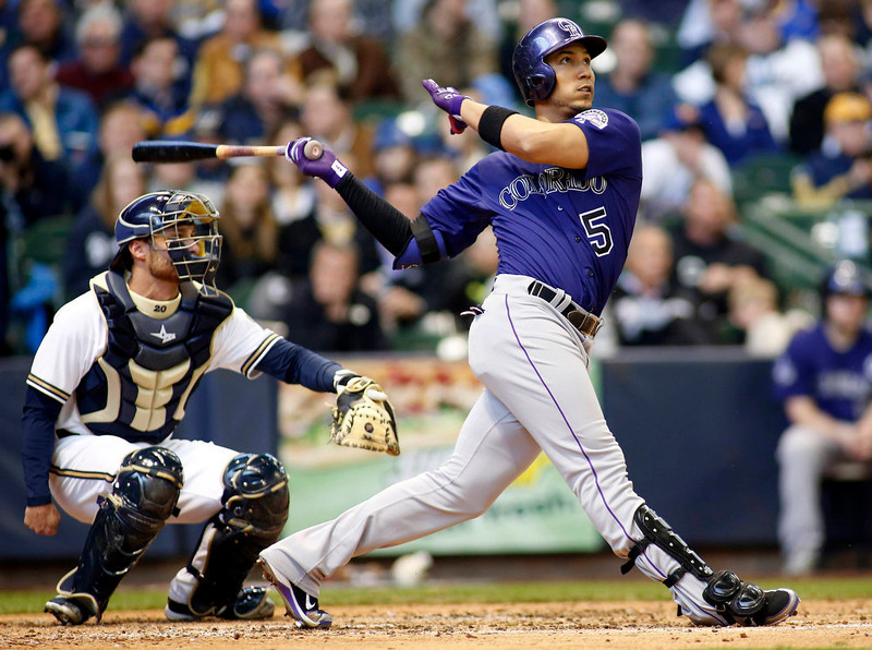 . Colorado Rockies left fielder Carlos Gonzalez hits a home run against the Milwaukee Brewers during the fifth inning in a MLB baseball game in Milwaukee, Wisconsin April 1, 2013. Brewers beat the Rockies in extra innings 5-4. REUTERS/Darren Hauck