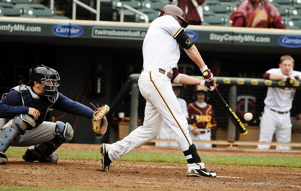 . Minnesota\'s Andy Henkemeyer strokes his game-winning single in the bottom of the ninth inning.  (Pioneer Press: Ben Garvin)