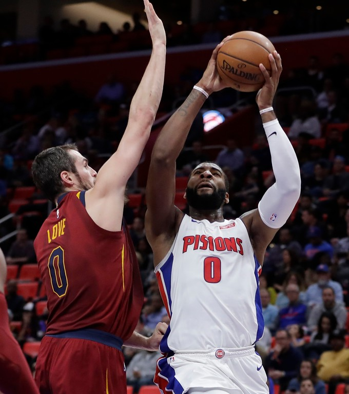 . Detroit Pistons center Andre Drummond (0) shoots as Cleveland Cavaliers forward Kevin Love (0) defends during the first half of an NBA basketball game, Monday, Nov. 20, 2017, in Detroit. (AP Photo/Carlos Osorio)