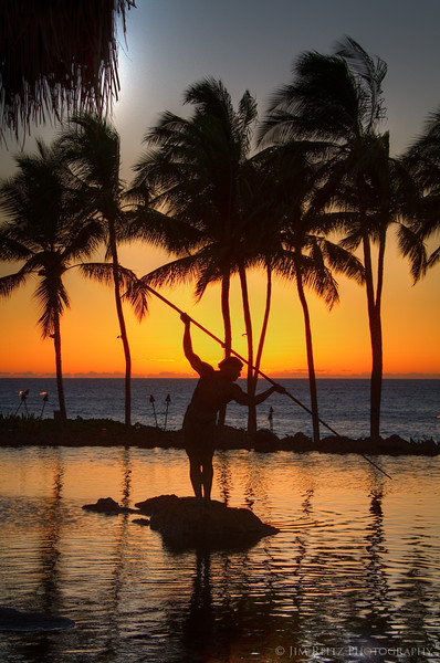 Sunset behind the spear-fisherman statue at Humuhumu...