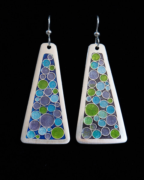 Fine Silver Champlevé and Cloisonné  trapezoid earrings with bubble pattern.  One is on a blue background, the other on a purple background. 1 7/8 inches long by 7/8 inch wide at bottom. The drop from the earwire is approximately 2 1/2 inches. Sterling silver ear wires and bead. 120.00