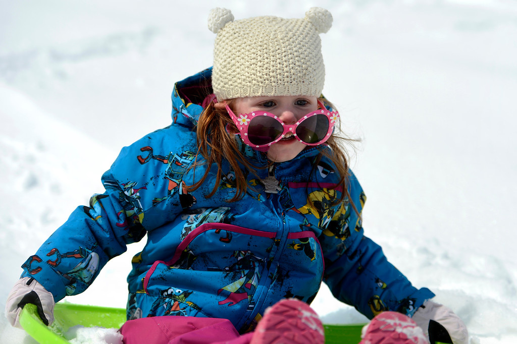 . BOULDER, CO. - APRIL 23: 2 year old Bailey Berggren loosing her glasses as she slides down the hill at Scott Carpenter Park April 23, 2013 Boulder, Colorado. (Photo By Joe Amon/The Denver Post)