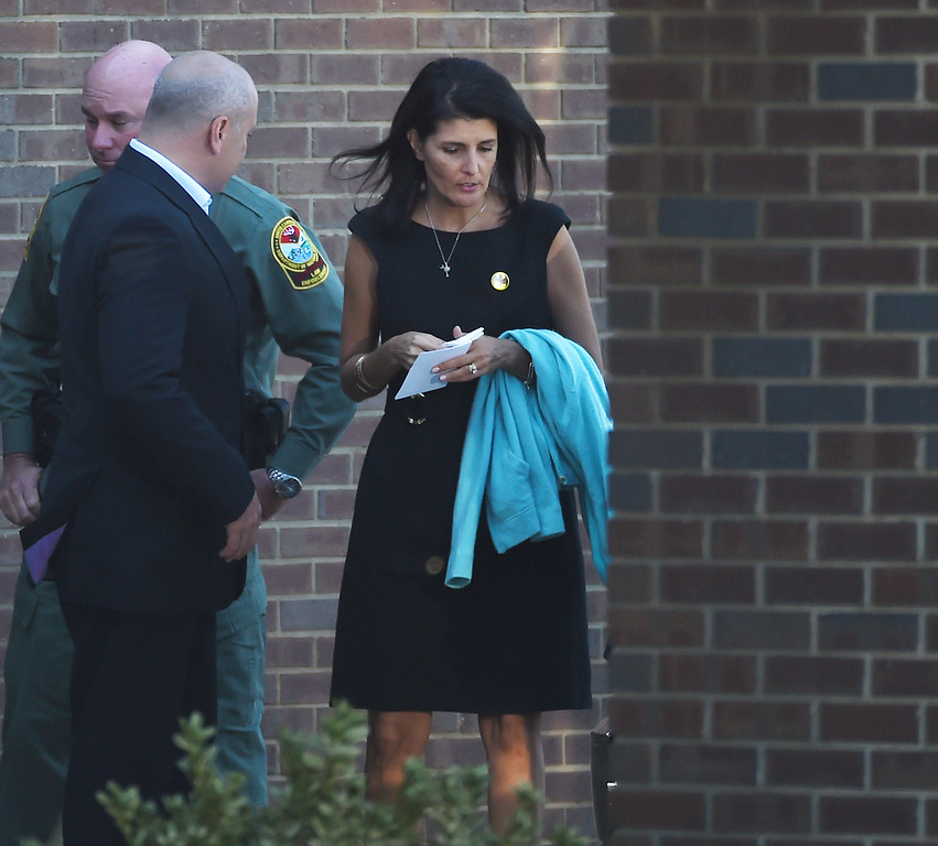 . South Carolina Gov. Nikki Haley, right, exits following a superhero-themed funeral service for Jacob Hall at Oakdale Baptist Church on Wednesday, Oct. 5, 2016, in Townville, S.C. A 14-year-old boy killed his own father, then drove to Townville Elementary and fired on two children and a teacher as recess began. Jacob died Saturday. (AP Photo/Rainier Ehrhardt)