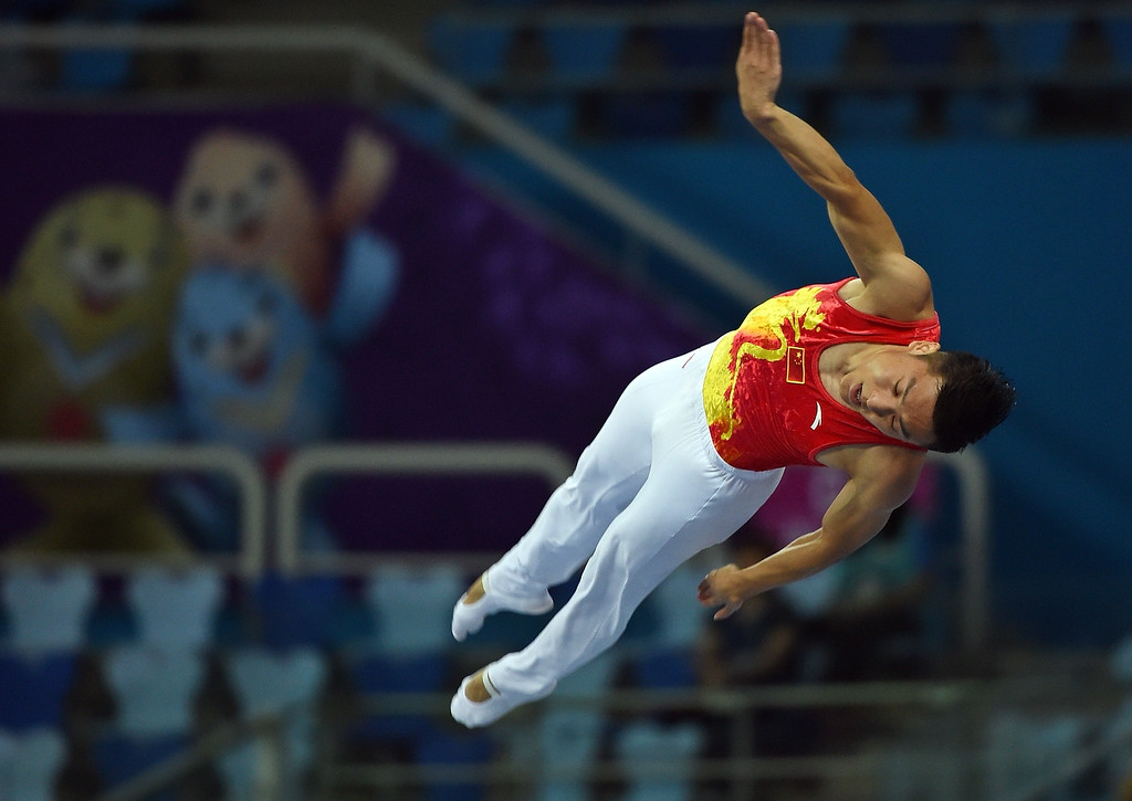 . Dong Dong of China performs in the men\'s gymnastics trampoline final event at the Namdong Gymnasium during the17th Asian Games in Incheon on September 26, 2014. PRAKASH SINGH/AFP/Getty Images