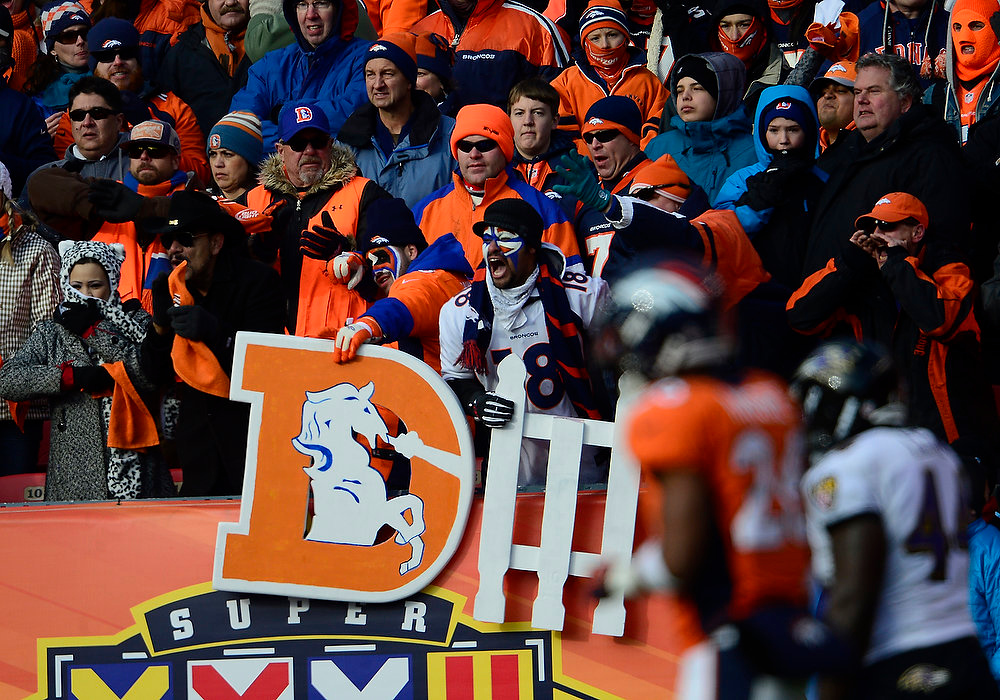 . Broncos fans cheer on the defense in the first quarter. The Denver Broncos vs Baltimore Ravens AFC Divisional playoff game at Sports Authority Field Saturday January 12, 2013. (Photo by AAron  Ontiveroz,/The Denver Post)