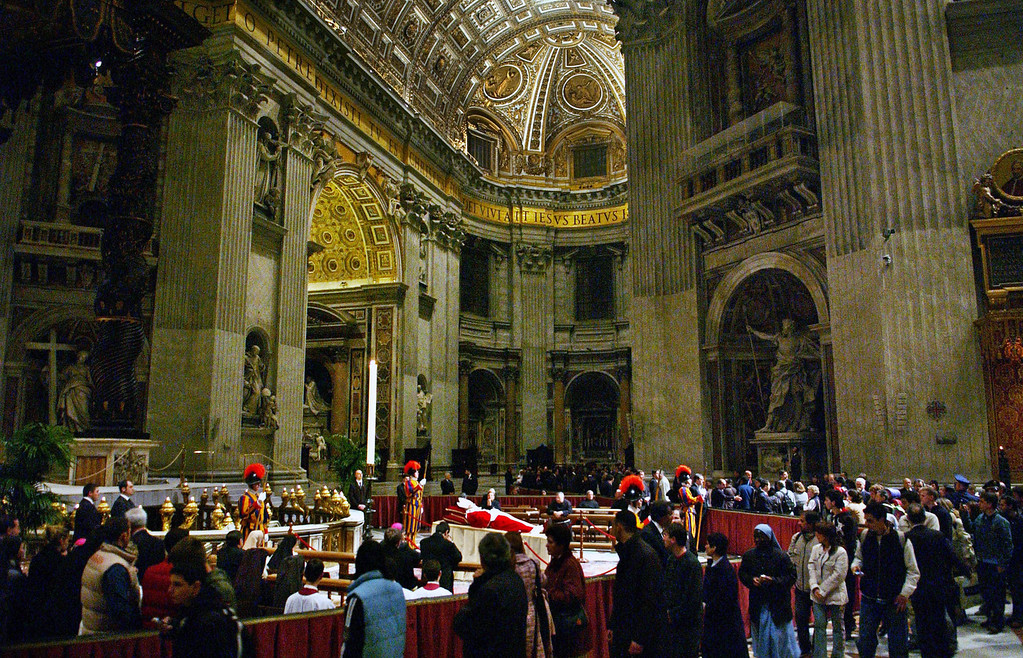 . The body of Pope John Paul II lies in state in Saint Peter\'s Basilica in Vatican City on Monday, April 4, 2005. In a slow, solemn ceremony the pope\'s body was moved from the Apostolic Palace in Vatican City to St. Peter\'s Basilica on Monday where it will lie in state for public viewing before his funeral on Friday.  (Lynsey Addario/The New York Times)