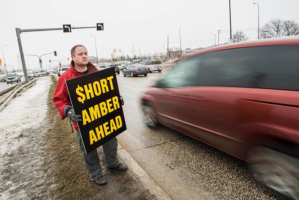 DAVID LIPNOWSKI / WINNIPEG FREE PRESS   Todd Dube of Wise Up Winnipeg brings attention to Bishop Grandin Blvd & St Mary's Rd intersection Sunday January 22, 2017.