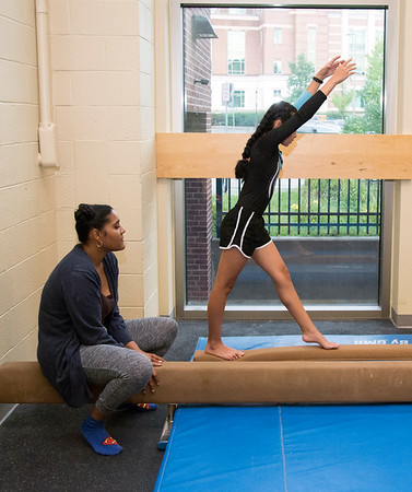 08/22/19 Wesley Bunnell | Staff The New Britain YWCA held an open house on Thursday August 22, 2019 to showcase the programs and benefits for prospective members by having them visit scavenger hunt stations each with a different theme. YWCA gymnastics team member Makaila Matos practices on the balance beam as instructor Gisselle Guadalupe watches.