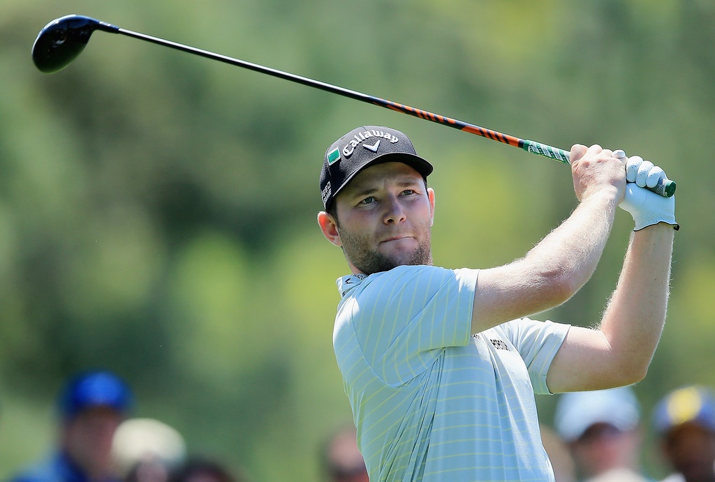 . Branden Grace of South Africa hits a shot during a practice round prior to the start of the 2014 Masters Tournament at Augusta National Golf Club on April 9, 2014 in Augusta, Georgia.  (Photo by David Cannon/Getty Images)