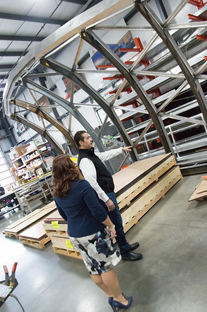 02/15/19 Wesley Bunnell | Staff Mayor Erin Stewart and Sign Pro President Peter Rappoccio look over decorative trim pieces for the Beehive Bridge that Sign Pro is building at its Southington location. The Mayor, along with other city employees, toured Sign Pro on Friday for progress updates.