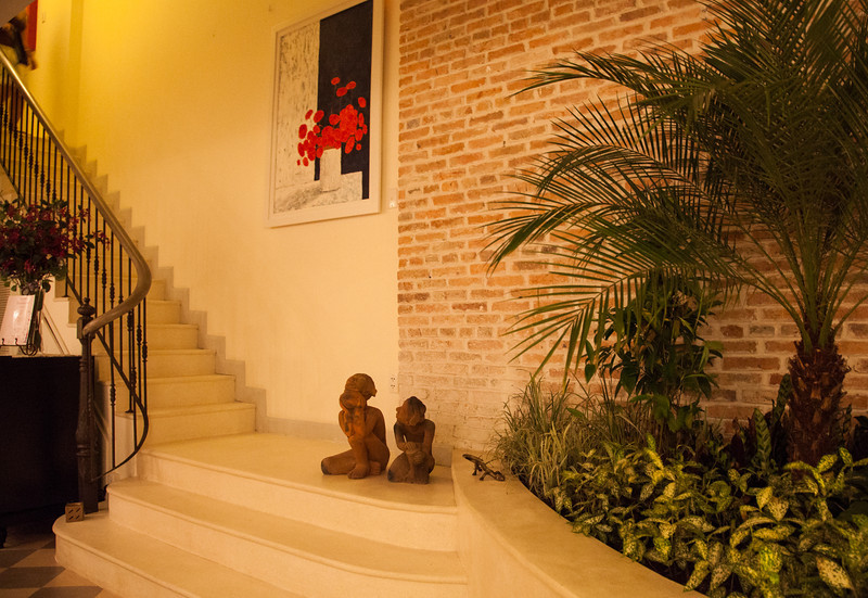 The stairs and indoor plants at Ma Maison in HCMC.