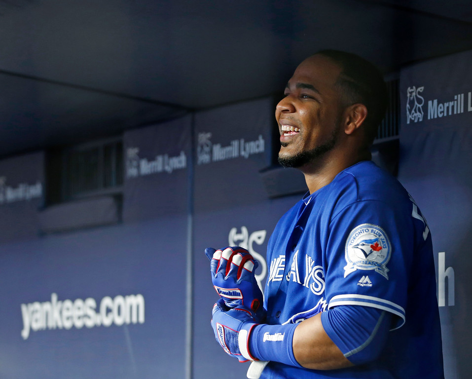 . Toronto Blue Jays\' Edwin Encarnacion smiles in the dugout after hitting an eighth-inning, two-run off New York Yankees relief pitcher Adam Warren in a baseball game in New York, Tuesday, Aug. 16, 2016. The Blue Jays defeated the Yankees 12-6. (AP Photo/Kathy Willens)