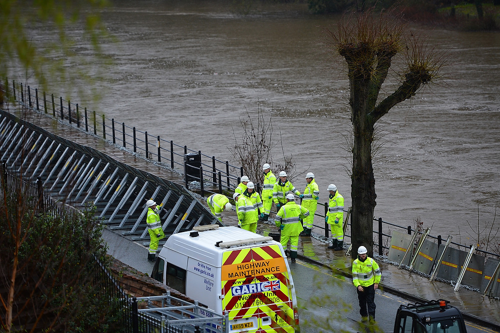 . Workers prepare to erect flood barriers alongside the River Severn at Ironbridge in Shropshire, mid-Wales on December 24, 2012. Heavy flooding across parts of Britain caused widespread road and rail disruption, wreaking havoc on Christmas travel plans while rescuers worked to evacuate people from the hardest-hit communities. ANDREW YATES/AFP/Getty Images