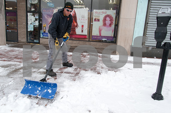 01/17/18 Wesley Bunnell   Staff A worker from Northeast Snow Removal shovels the sidewalk near Central Park on Wednesday morning after a new storm spread several inches of snow.