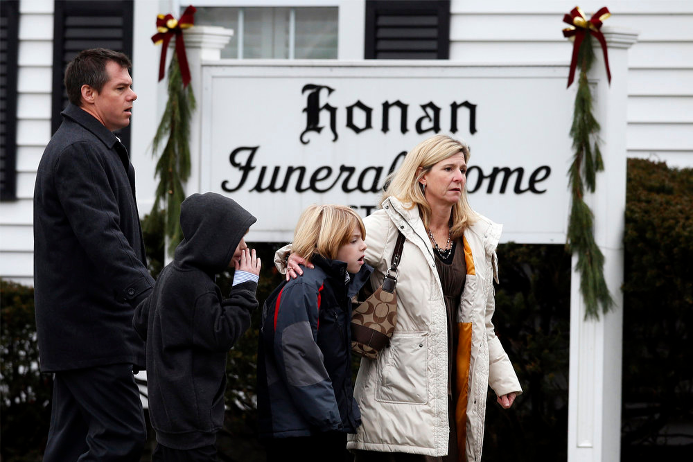 Description of . Mourners arrive at the Honan Funeral Home, where the family of six-year-old Jack Pinto is holding his funeral service, in Newtown, Connecticut December 17, 2012. Pinto was one of the 20 students killed in the December 14 shootings at Sandy Hook Elementary School in Newtown. REUTERS/Mike Segar