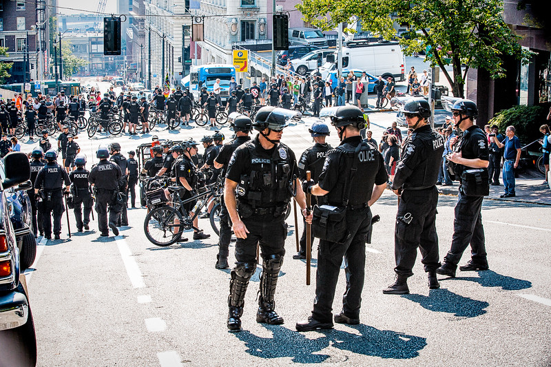 """As the """"Liberty or Death"""" rally comes to a close, police officers gather at 4th Ave and Cherry St to begin escorting far-right supporters away from the area."""