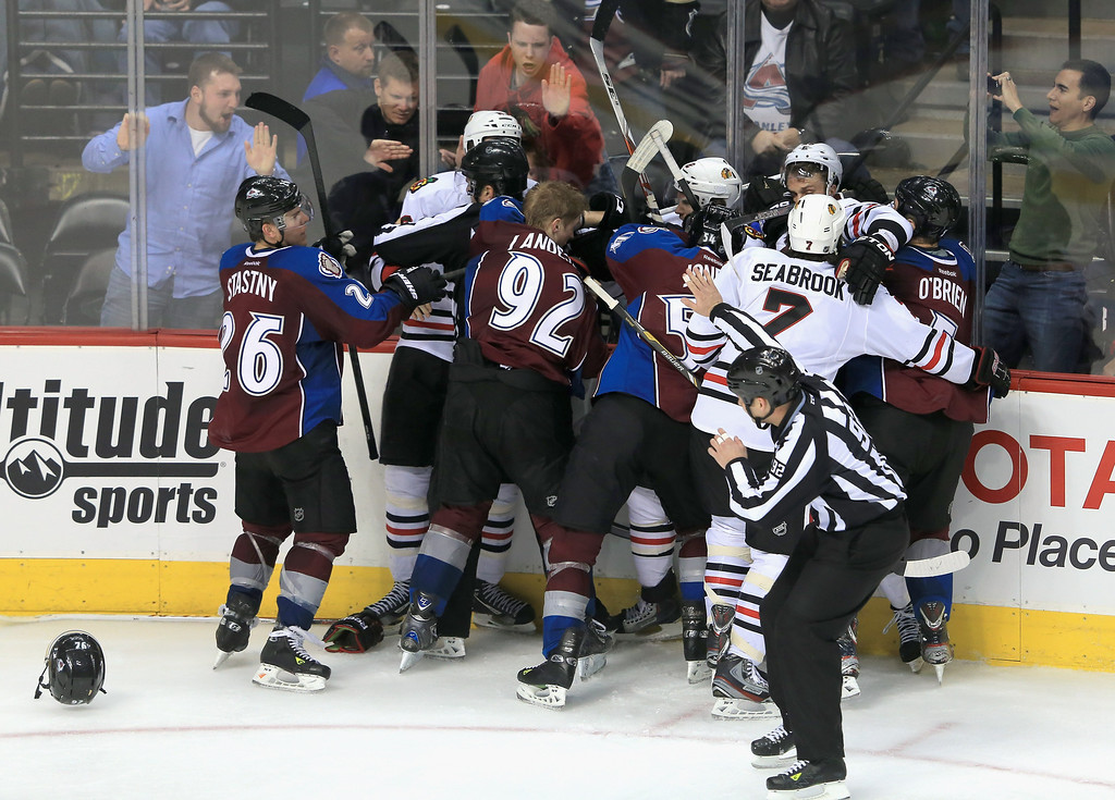 . DENVER, CO - MARCH 08:  Tempers flare as the Chicago Blackhawks and the Colorado Avalanche scuffle at the Pepsi Center on March 8, 2013 in Denver, Colorado. The Avalanche won 6-2 to end the Blackhawks 30 game undefeated streak.  (Photo by Doug Pensinger/Getty Images)