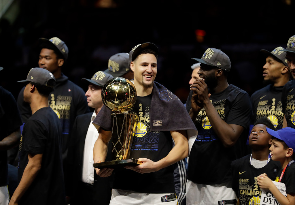 . Golden State Warriors\' Klay Thompson celebrates after the Warriors defeated the Cleveland Cavaliers 108-85 in Game 4 of basketball\'s NBA Finals to win the NBA championship, Friday, June 8, 2018, in Cleveland. (AP Photo/Tony Dejak)