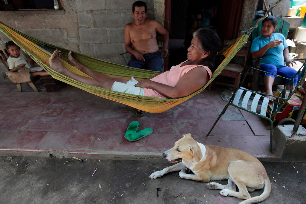 . An indigenous woman rests in a hammock with her family at the indigenous community of Monimbo in Masaya City, about 24 km (15 miles) south of Managua, April 9, 2013.  Indigenous representatives from Bolivia, Chile, Colombia, Ecuador, Guatemala, Honduras, Mexico, Nicaragua, Panama, Peru and Venezuela will analyze the food security of their peoples during the 13th ordinary session of the Indigenous Parliament of America (PIA) held in the city of Managua.   REUTERS/Oswaldo Rivas
