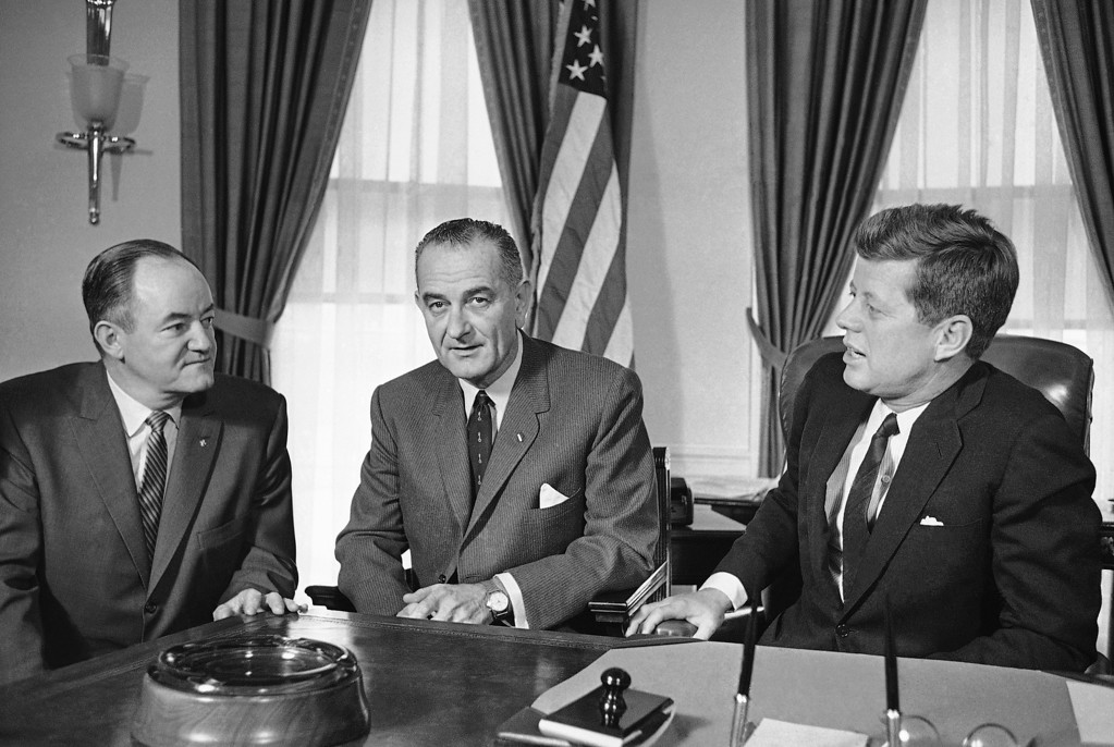 . Kennedy, Johnson and Sen. Hubert Humphrey, D-Minn., confer in the White House after meeting of Democratic legislative leaders Feb. 7, 1961, in Washington. Henry Burroughs, Associated Press file