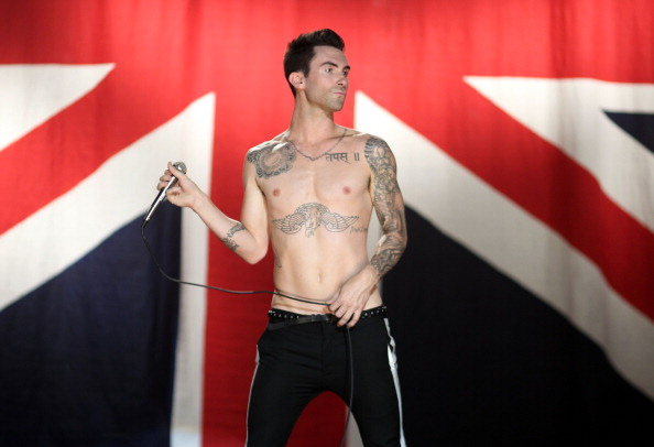 """. LOS ANGELES, CA - JULY 08:  Musician Adam Levine of the band Maroon 5 performs at the Maroon 5 Video Shoot for \""""Moves Like Jagger\"""" with Christina Aguilera on July 8, 2011 in Los Angeles, California.  (Photo by Christopher Polk/Getty Images for A&M/Octone)"""