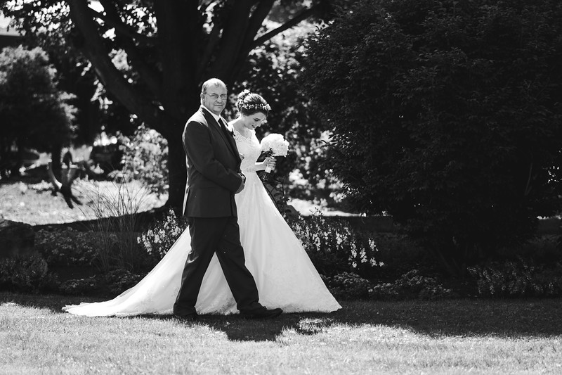 Bride and her father walking down the isle.