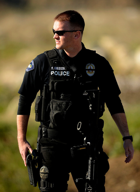 . Redlands Police Redlands Police Officer K. Knudsen stands guard at a blockade along Highway 38 and Bryant Street near the Mill Street Ranger Station west of Yucaipa February 12, 2013.  Authorities believe that they exchanged gunfire with fugitive Christopher Dorner in the Angles Oaks area of the San Bernardino National Forest.  Fish and Game officers spotted a man fitting the description of Dorner driving a white pick-up and  exchanged gunfire with him. (Staff photo by Gabriel Luis Acosta/The Sun)