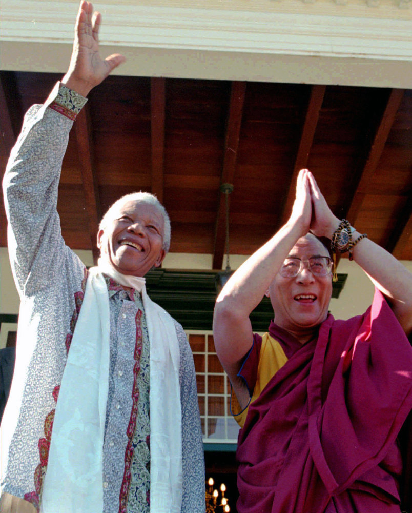 Description of . In this Wednesday August 21, 1996, file photo Tibetan leader the Dalai Lama, right, meets with President Nelson Mandela, left, in Cape Town South Africa. South Africa said Monday, March 23, 2009,  it wanted to avoid being the source of bad publicity about trading partner China, and ended up itself the target of sharp criticism for barring the Dalai Lama from a peace conference in Johannesburg later this week. Friday's conference is now the target of a boycott by retired Cape Town Archbishop Desmond Tutu, former president F.W. de Klerk and members of the Nobel Committee who had been expected to be among Nobel laureates, Hollywood celebrities and other dignitaries discussing issues ranging from combatting racism to promoting sports to bring people and nations together. (AP Photo/Sasa Kralj, File)