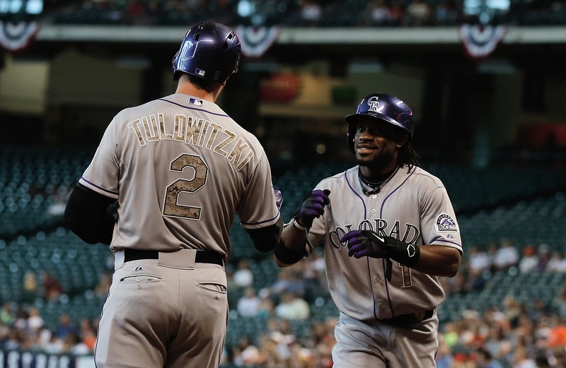 . Eric Young Jr. #1  of the Colorado Rockies is greeted by Troy Tulowitzki #2 after scoring a run during the first inning against the Houston Astros at Minute Maid Park on May 27, 2013 in Houston, Texas.  (Photo by Scott Halleran/Getty Images)