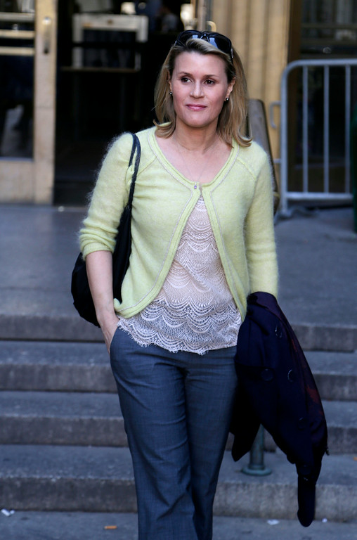 ". In this April 8, 2013 file photo, Canadian actress Genevieve Sabourin leaves court in New York. Sabourin was convicted in November 2013 of stalking Baldwin with emails, phone calls, and unsolicited visits to his Manhattan apartment. Sabourian and Baldwin met in 2000 on a movie set and had dinner a decade later, and the actress said Baldwin made promises of a life together. The judge who sentenced her said no matter what happened between the two, Sabourin had no right to pursue contact she knew to be unwanted and amounted to a ""relentless and escalating campaign of threats and in-person appearances.\"" (AP Photo/Seth Wenig, file)"