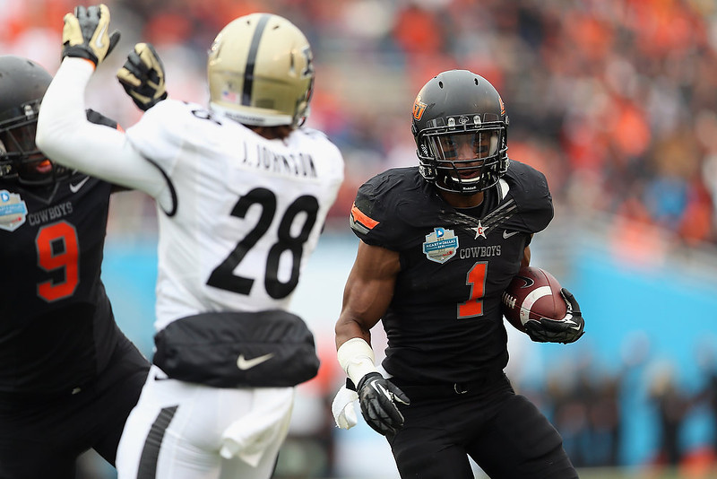 . Joseph Randle #1 of the Oklahoma State Cowboys runs the ball against the Purdue Boilermakers during the Heart of Dallas Bowl at Cotton Bowl on January 1, 2013 in Dallas, Texas.  (Photo by Ronald Martinez/Getty Images)