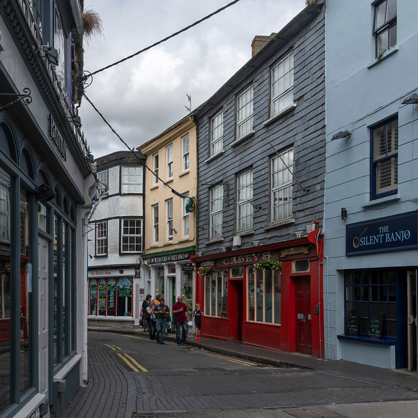 View of people and buildings seen across the street, Kinsale, County Cork, Ireland