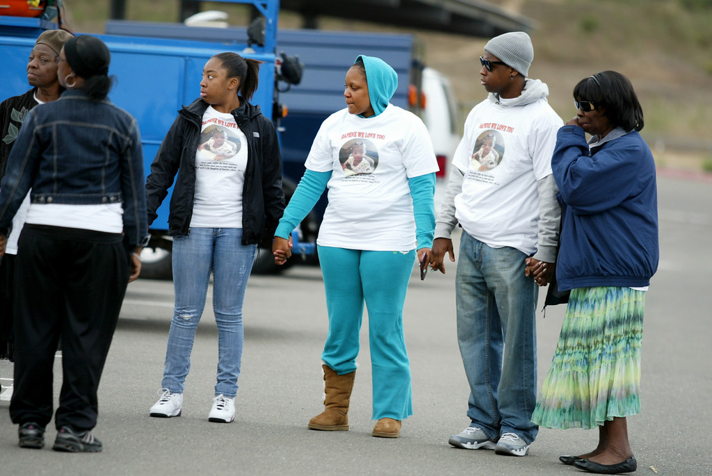 . Family members of missing 22-month-old Daphne Webb make a circle of prayer as Oakland oolice,along with Alameda County Sheriff and Santa Clara County Sheriff volunteer rescue teams and FBI agencies, begin the search for the child near Merritt College in Oakland, Calif., on Saturday, Aug. 24, 2013. (Ray Chavez/Bay Area News Group)
