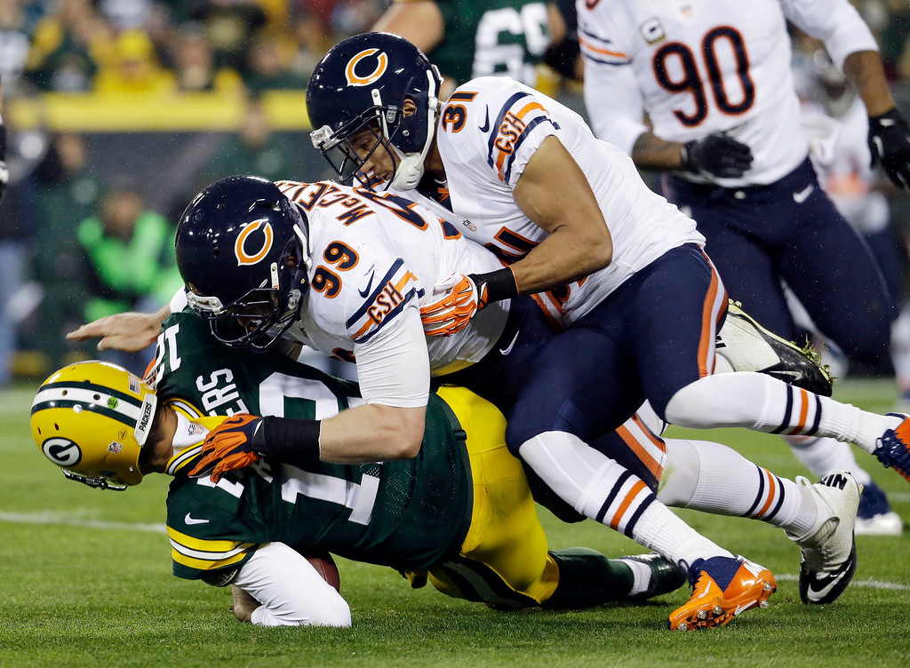. Green Bay Packers quarterback Aaron Rodgers is sacked by Chicago Bears\' Shea McClellin (99) and Isaiah Frey (31) during the first half of an NFL football game Monday, Nov. 4, 2013, in Green Bay, Wis. (AP Photo/Morry Gash)