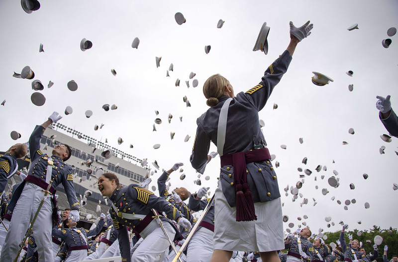 . The 2014 graduating class at the United States Military Academy at West Point, New York, throw their covers in the air at the end of the ceremony May 28, 2014.  (JIM WATSON/AFP/Getty Images)