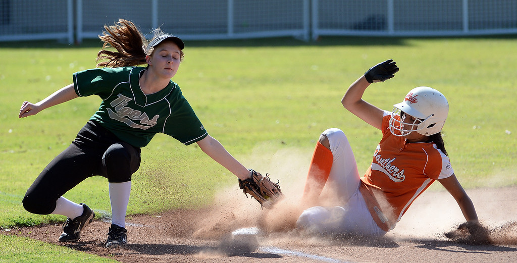 . Poly\'s Shalini Haupt save at third base under the tag of Westridge\'s Grace Wallis in the first inning of a prep softball game at Westridge High School in Pasadena, Ca on Tuesday, April 15, 2014. Poly won 11-1. (Keith Birmingham Pasadena Star-News)