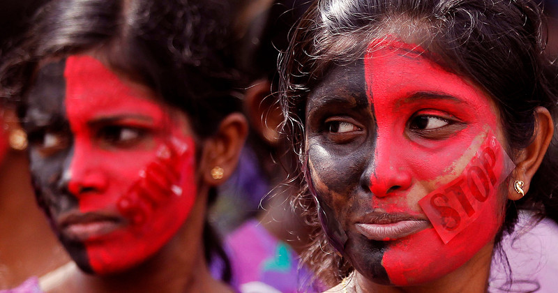 . Sri Lankan women looks on before a protest to mark International Women\'s Day in Colombo March 8, 2013. Protesters demanded government action for domestic violence and rape issues in the country.   REUTERS/Dinuka Liyanawatte