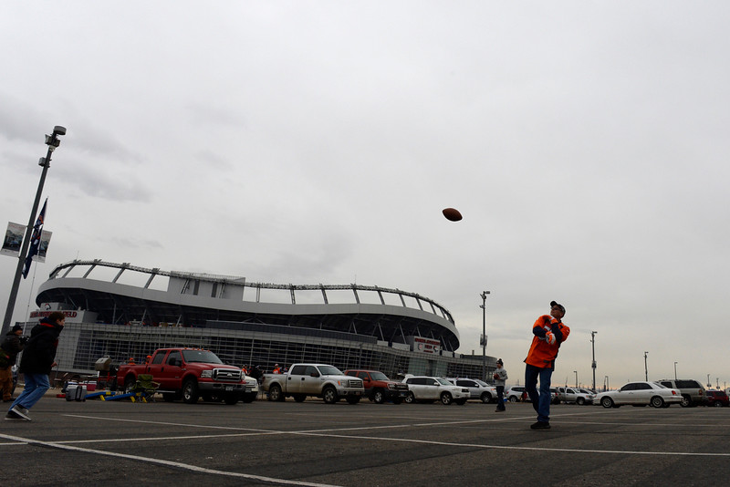 . Broncos fans play catch in the parking lots before the game. The Denver Broncos played the Indianapolis Colts in an AFC divisional playoff game at Sports Authority Field at Mile High in Denver on January 11, 2015. (Photo by Craig F. Walker/The Denver Post)