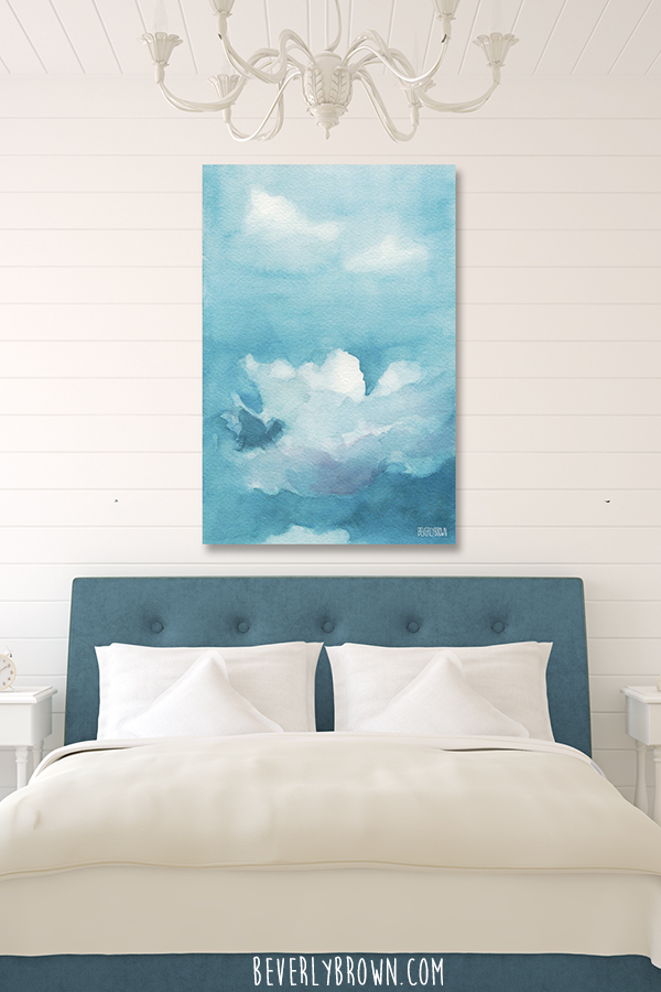 Cozy Blue and White Feminine Bedroom with Calming Clouds Artwork Over Bed