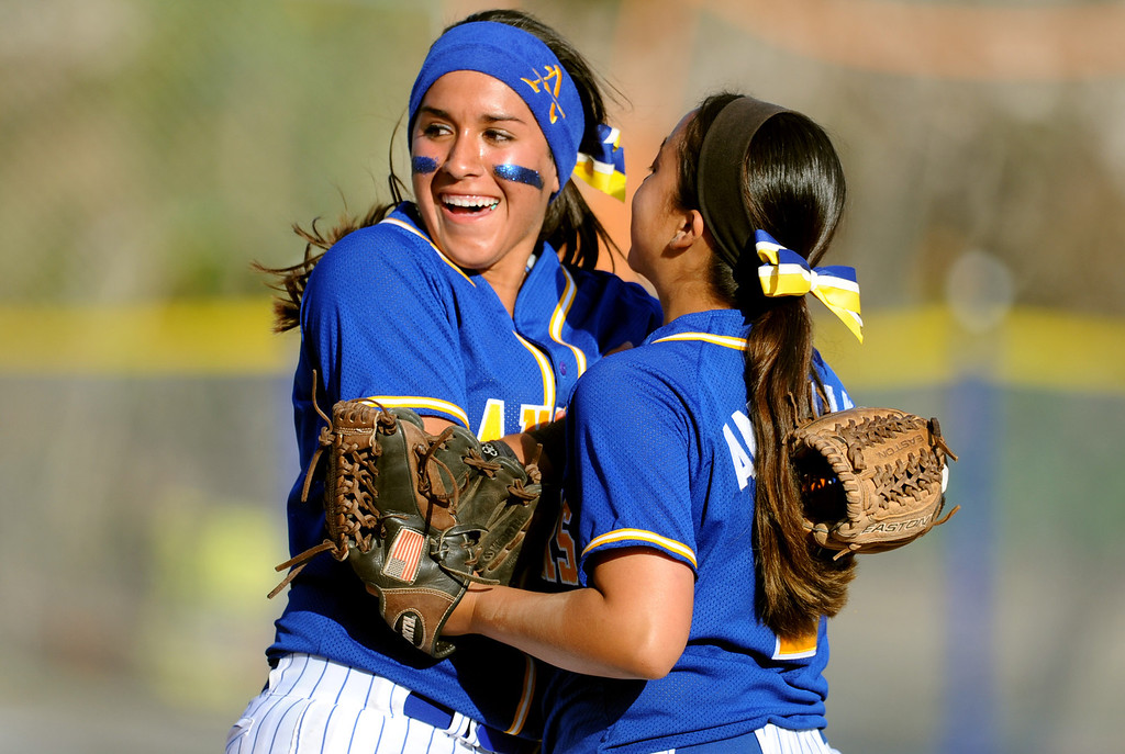 . Bishop Amat\'s Brandy Galaviz ©, left, reacts with teammate Sabrina Anguiano after defeating Santiago 5-3 during a prep softball game at Bishop Amat High School on Wednesday, March 27, 2013 in La Puente, Calif.  (Keith Birmingham Pasadena Star-News)